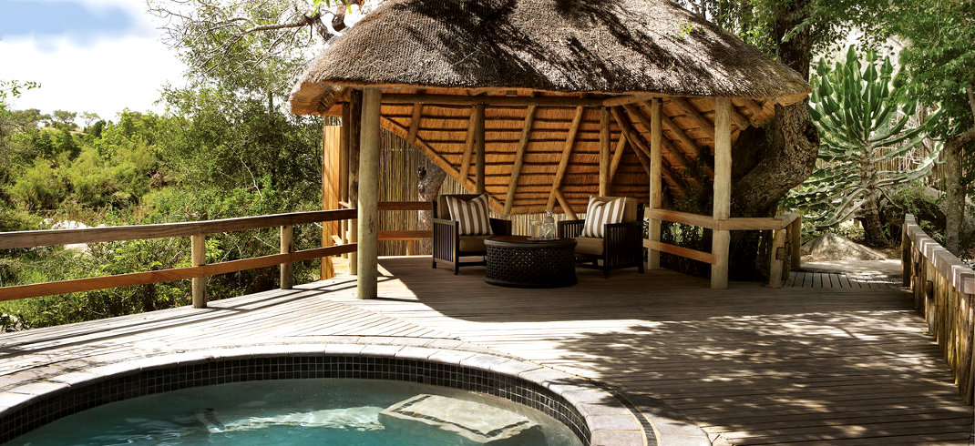 A sala next to the private pool of a luxury suite at Londolozi Founders Camp