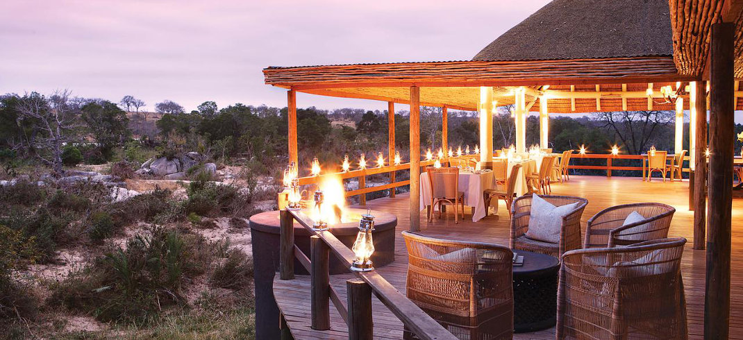 The well-lit main deck contrasts well with the darkness of sunset in Sabi Sands.